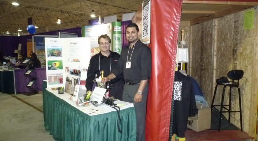 treb show, two men smiling in front of green and white table