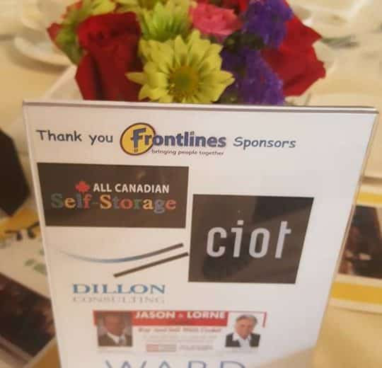 colourful flowers as the center piece of the table, small sign on the table with thank you frontlines sponsors