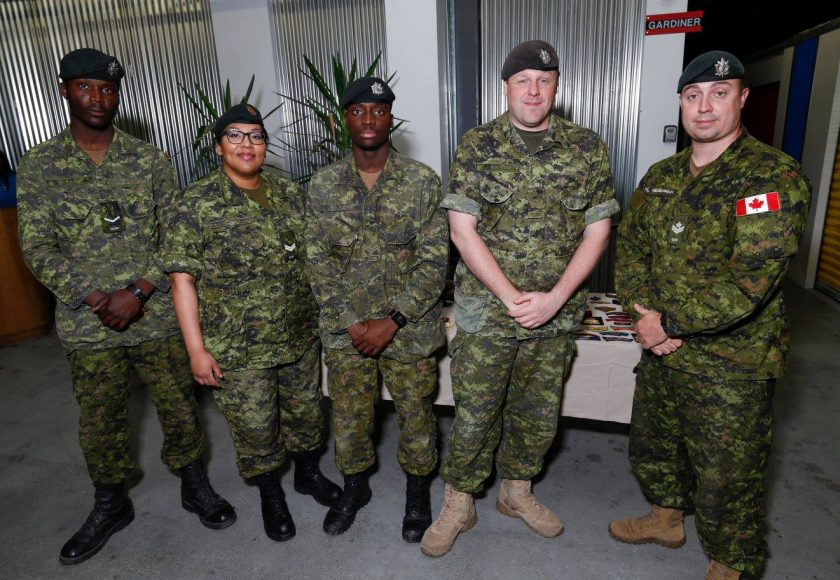 Queen's Own Rifles of Canada March, five people in green uniform standing