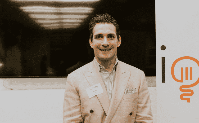 Leslie Kellen, man wearing a striped dress shirt and a light brown blazer jacket, standing and smiling at the camera, ignite capital pitch competition