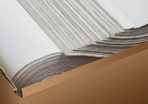 stack of white wrapping paper in brown box