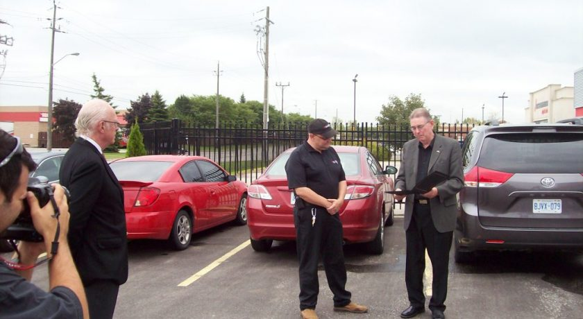 4 men in a parking lot at the 25 Year Anniversary for Brantford General Manager
