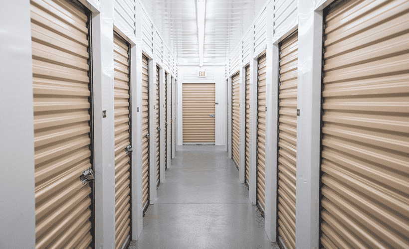 Beechgrove facility self storage units, white walls and beige unit doors