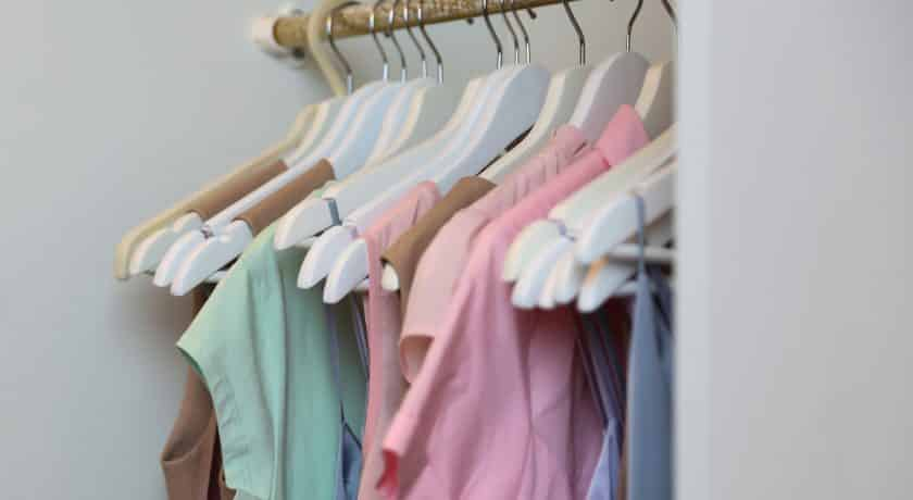 hangers with women's dresses and other colorful clothes
